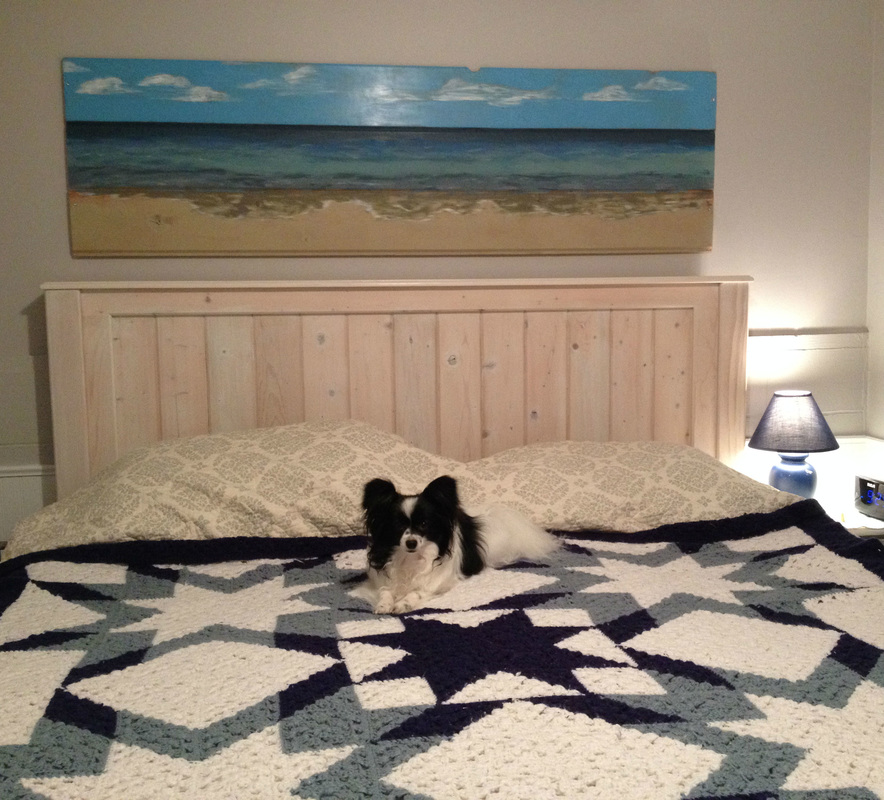 Beach painting on wood over headboard
